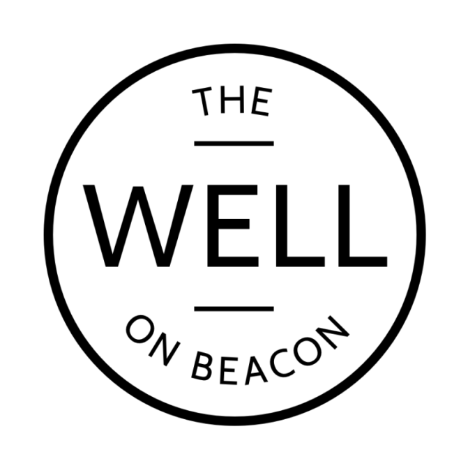 Black white circular logo of The Well on Beacon